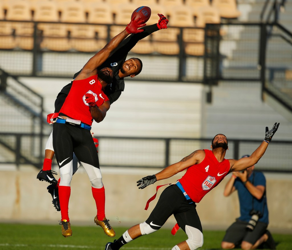 IMAGE DISTRIBUTED FOR THE AMERICAN FLAG FOOTBALL LEAGUE - From left, Code Red's Darnell Jenkins, The Money Team's Will Cole, and Code Red's Christopher Linares, reach for the ball during a semifinal game at the American Flag Football League (AFFL) U.S. Open of Football tournament, Sunday, July 8, 2018 in Kennesaw, Ga. (Todd Kirkland/AP Images for American Flag Football League)
