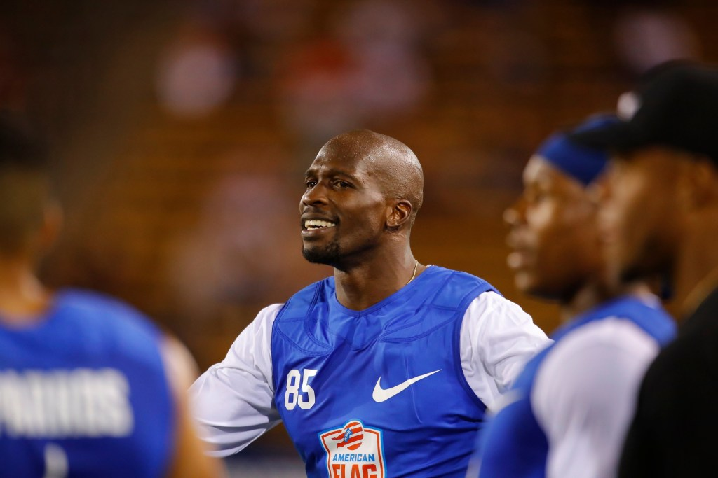 IMAGE DISTRIBUTED FOR THE AMERICAN FLAG FOOTBALL LEAGUE - Ocho's Chad Ochocinco smiles during a semifinal game against Ocho during the American Flag Football League (AFFL) U.S. Open of Football tournament, Saturday, July 7, 2018 in Kennesaw, Ga. (Todd Kirkland/AP Images for American Flag Football League)