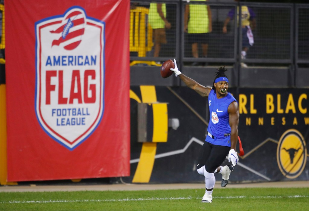 IMAGE DISTRIBUTED FOR THE AMERICAN FLAG FOOTBALL LEAGUE - Ocho's Jeremy Ross celebrates a touchdown against Roadrunners during the American Flag Football League (AFFL) U.S. Open of Football tournament, Saturday, July 7, 2018 in Kennesaw, Ga. (Todd Kirkland/AP Images for American Flag Football League)