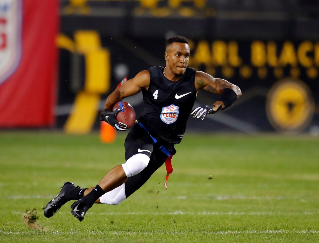 IMAGE DISTRIBUTED FOR THE AMERICAN FLAG FOOTBALL LEAGUE - Godspeed's Jahvid Best runs with the ball during a semifinal game against Holdat at the American Flag Football League (AFFL) U.S. Open of Football tournament, Sunday, July 8, 2018 in Kennesaw, Ga. (Todd Kirkland/AP Images for American Flag Football League)