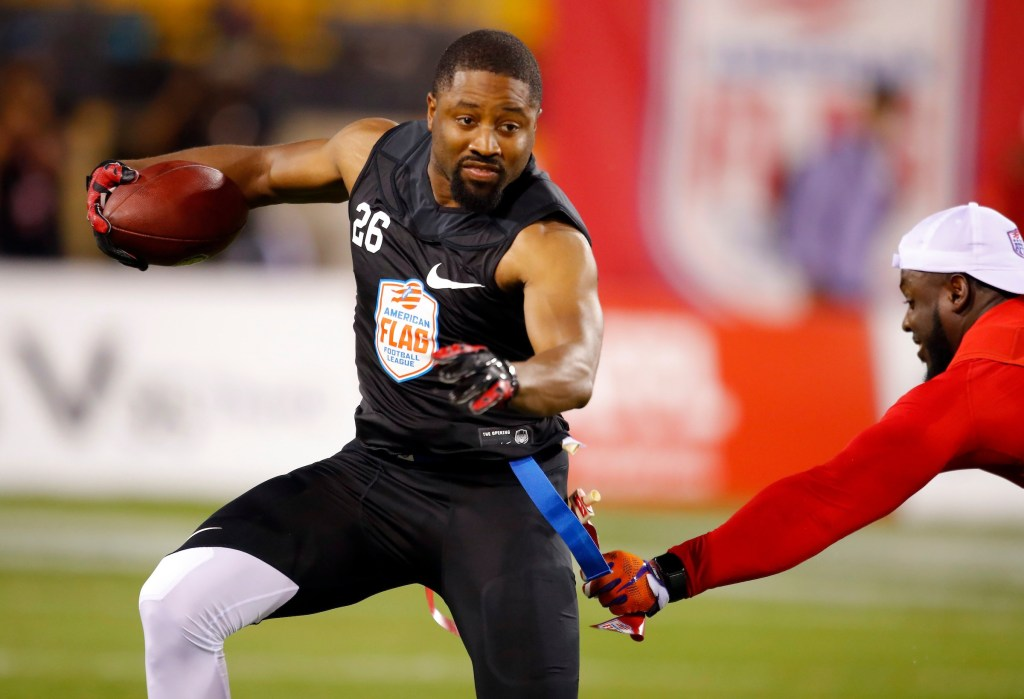 IMAGE DISTRIBUTED FOR THE AMERICAN FLAG FOOTBALL LEAGUE - Godspeed's Josh Wilson's flag is pulled during a semifinal game against Holdat at the American Flag Football League (AFFL) U.S. Open of Football tournament, Sunday, July 8, 2018 in Kennesaw, Ga. (Todd Kirkland/AP Images for American Flag Football League)