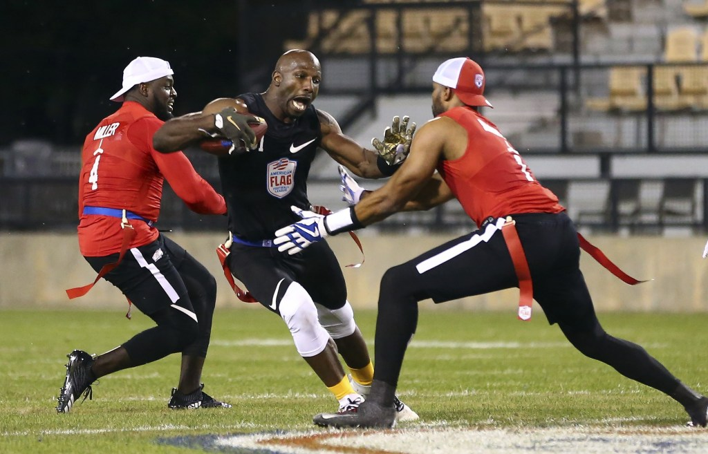 IMAGE DISTRIBUTED FOR THE AMERICAN FLAG FOOTBALL LEAGUE - Godspeed's Jason Avant tries to avoid the flag pull during a semifinal game against Holdat at the American Flag Football League (AFFL) U.S. Open of Football tournament, Sunday, July 8, 2018 in Kennesaw, Ga. (Kevin D. Liles/AP Images for American Flag Football League)