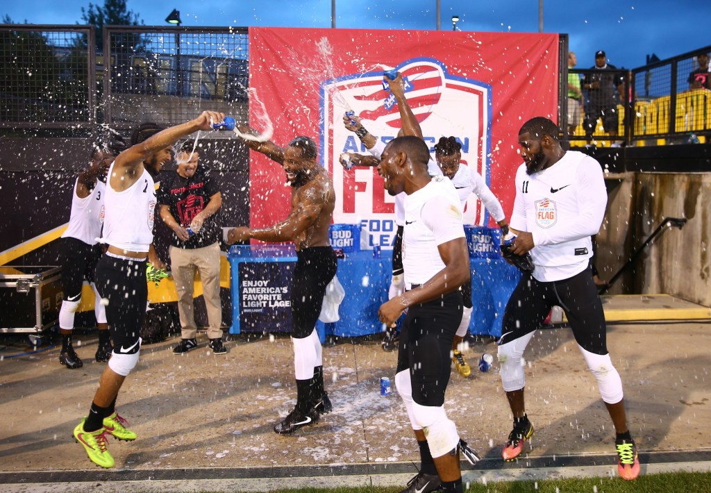 Fighting Cancer celebrates their win over Primetime at the American Flag Football League (AFFL) U.S. Open of Football tournament, Saturday, July 7, 2018 in Kennesaw, Ga. (Kevin D. Liles/AP Images for American Flag Football League)