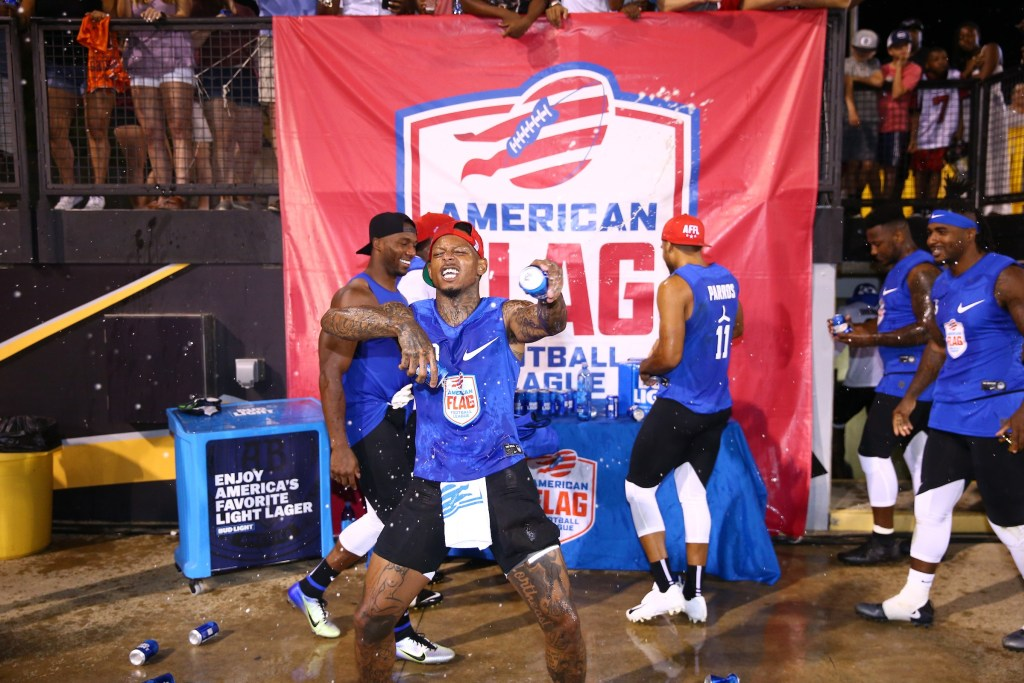 Members of Ocho celebrate their semifinal win against Roadrunners at the American Flag Football League (AFFL) U.S. Open of Football tournament, Saturday, July 7, 2018 in Kennesaw, Ga. (Kevin D. Liles/AP Images for American Flag Football League)