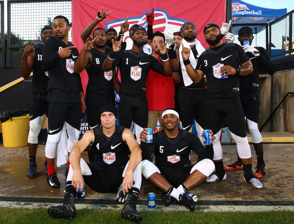 Members of The Money Team pose for a photo after winning their semifinal game against Code Red at the American Flag Football League (AFFL) U.S. Open of Football tournament, Sunday, July 8, 2018 in Kennesaw, Ga. (Kevin D. Liles/AP Images for American Flag Football League)