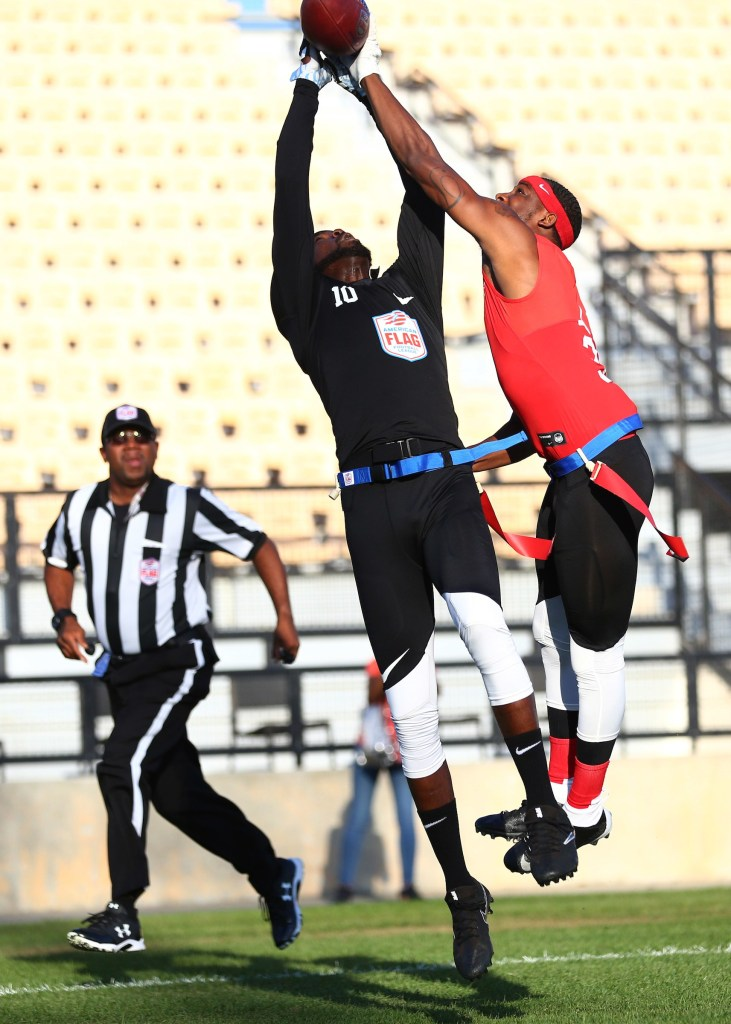 The Money Team's Alfred McDonald Jr. and Code Red's Tyrell Wright go up for the ball at the American Flag Football League (AFFL) U.S. Open of Football tournament, Sunday, July 8, 2018 in Kennesaw, Ga. (Kevin D. Liles/AP Images for American Flag Football League)