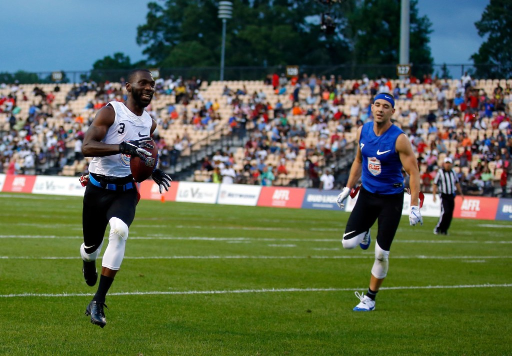 Fighting Cancer's Brandon McCray runs the ball in for a touchdown during a semifinal round game against Primetime at the American Flag Football League (AFFL) U.S. Open of Football tournament, Saturday, July 7, 2018 in Kennesaw, Ga. (Todd Kirkland/AP Images for American Flag Football League)