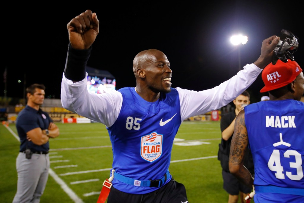 Ocho's Chad Ochocinco celebrates his team's semifinal win at the American Flag Football League (AFFL) U.S. Open of Football tournament, Saturday, July 7, 2018 in Kennesaw, Ga. (Todd Kirkland/AP Images for American Flag Football League)