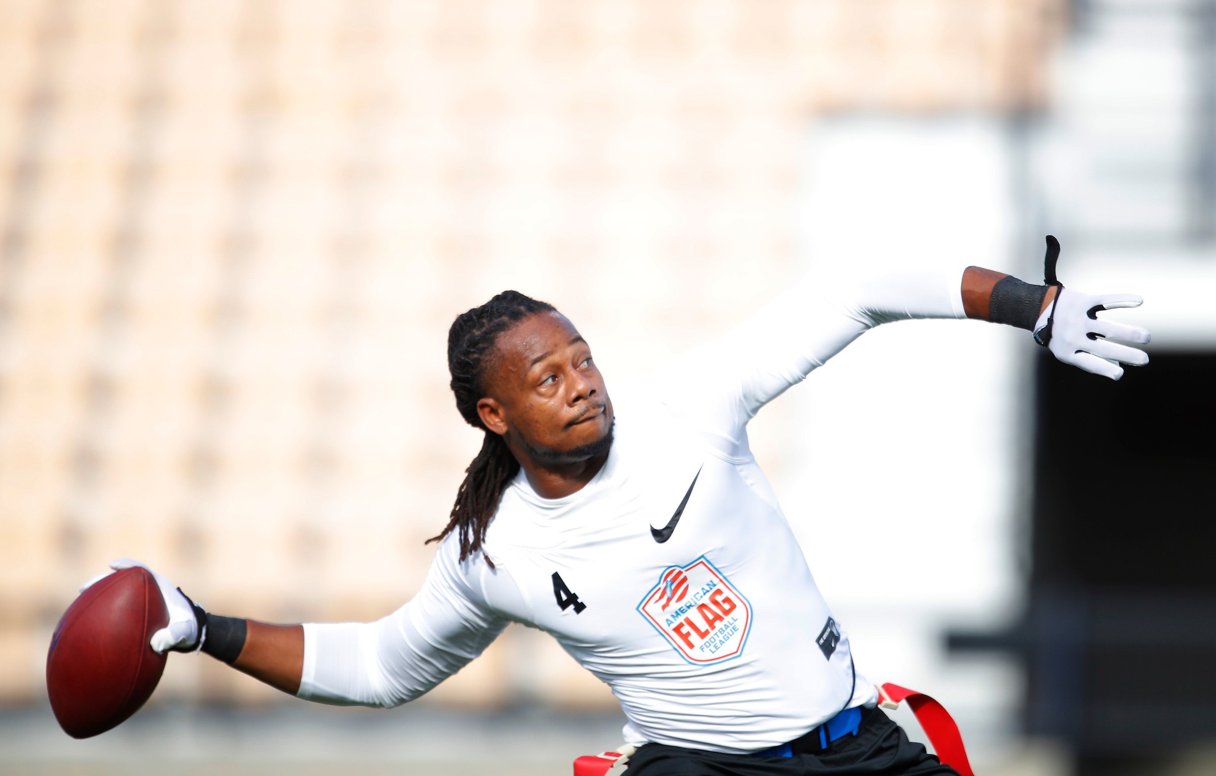 Fighting Cancer's Darius Davis warms up prior to before the semifinal round of the American Flag Football League (AFFL) U.S. Open of Football tournament, Saturday, July 7, 2018 in Kennesaw, Ga. (Todd Kirkland/AP Images for American Flag Football League)