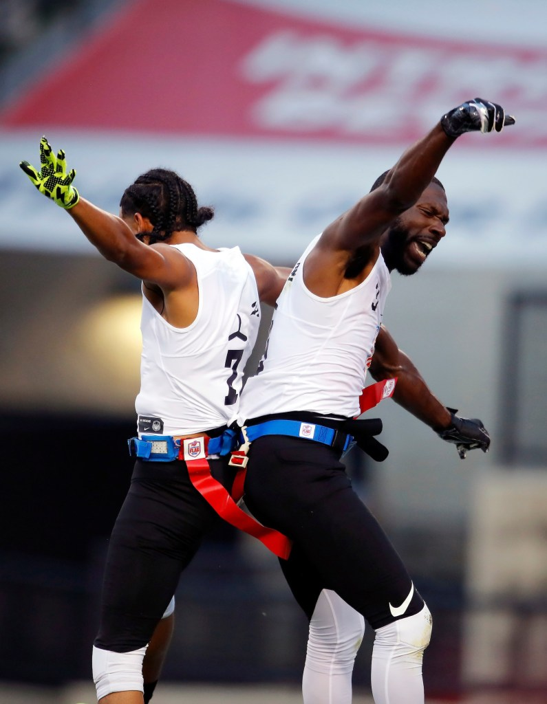 Fighting Cancer's Darrell Doucette and Brandon McCray celebrate during their semifinal game against Primetime during the American Flag Football League (AFFL) U.S. Open of Football tournament, Saturday, July 7, 2018 in Kennesaw, Ga.  (Todd Kirkland/AP Images for American Flag Football League)