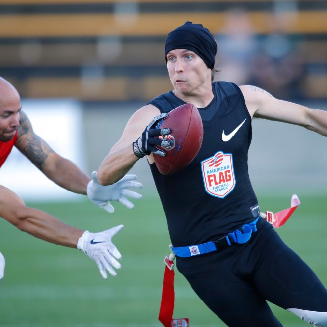 The Money Team's Greg Meek tries to avoid the flag pull during a semifinal game against Code Red at the American Flag Football League (AFFL) U.S. Open of Football tournament, Sunday, July 8, 2018 in Kennesaw, Ga. (Todd Kirkland/AP Images for American Flag Football League)